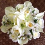 Tropical mix with white lilies and roses