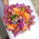 Tropical mix with orange roses