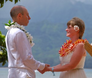 Closed ti leaf lei with white orchid wrap around and rainbow plumeria lei